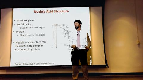 Dr. Chris Johnson presents a lecture on DNA properties.