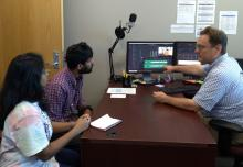 Dr. Fitzkee works with Dan and Radha on video edits with Davinci Resolve.